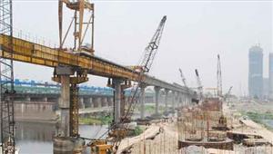 यमुना पुल निर्माण में देरी कंपनी पर पड़ न जाए भारी