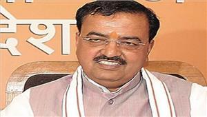 केशव प्रसाद मौर्य नेकमल स्टीकर के साथ किया मतदान